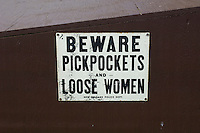 comical sign for a reward for pickpockets and loose women