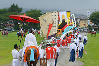 Procession through the race track, Somanomaoi Festival, Minami-soma City, Fukushima Prefecture, Japan, July 27, 2013. During the four-day-long Somanomaoi Festival members of old samurai families ride horseback through the town in traditional armour.  They also take conduct ceremonies at local shrines, take part in horse races, and compete on horseback to catch a flag launched into the air by fireworks.