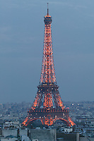 Eiffel Tower, with blinking lights of the hourly light show, at dusk, Paris, France