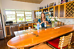 Olympic skier Julia Mancuso at her home on the island of Maui, Hawaii.  Julia making a smoothie in the kitchen that has a vintage surfboard as a bar.