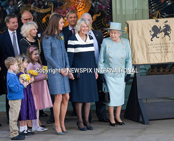 "KATE JOINS QUEEN AND CAMILLA FOR OFFICIAL ENGAGEMENT.The Royal Ladies undertook their first joint engagement when they visited Fortnum & Mason, where the Queen opened a new restaurant..The Queen later unveiled a plaque commenorating her Diamond Jubliee. .In celebration of St. David's Day, the royal ladies were then presented with posys of daffodils_London_01/03/2012.Mandatory Credit Photo: ©FRANCIS DIAS-NEWSPIX INTERNATIONAL..**ALL FEES PAYABLE TO: ""NEWSPIX INTERNATIONAL""**..IMMEDIATE CONFIRMATION OF USAGE REQUIRED:.Newspix International, 31 Chinnery Hill, Bishop's Stortford, ENGLAND CM23 3PS.Tel:+441279 324672  ; Fax: +441279656877.Mobile:  07775681153.e-mail: info@newspixinternational.co.uk"