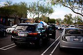 PHOENIX, ARIZONA, USA, 10/2016<br /> Teenager at the SUV car on a vast parking lot at the shopping mall Happy Valley. <br /> (Photo by Piotr Malecki / Napo Images)<br /> <br /> PHOENIX, ARIZONA, USA, 10/2016<br /> Nastolatek stoi na brzegu samochodu na wielkim parkingu przy centrum handlowym Happy Valley.<br /> Fot: Piotr Malecki / Napo Images<br /> <br /> <br />  ###ZDJECIE MOZE BYC UZYTE W KONTEKSCIE NIEOBRAZAJACYM OSOB PRZEDSTAWIONYCH NA FOTOGRAFII###