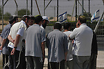 Settlers visit the cemetery, a day before the implementation of the Disengagement, at the Israeli settlement bloc of Gush Katif, Gaza Strip. The graves are to be uprooted and moved into Israel.