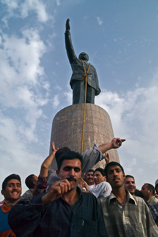 Baghdad, Iraq, April 9th 2003.A small group of Iraqis attempts to destroys the Saddam Hussein statue on Firous square.