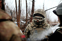 """UKRAINE, 02.2016, Oblast Donetsk. Ukrainian-Russian conflict concerning Eastern Ukraine / Foreign volunteers (""""Task Force Pluto"""") fighting with the far-right militia Pravyi Sektor against the Russian-backed separatists: Charlie (USA) turns up in Ben's trench in full body armour after having a firefight at another position close to the Donetsk frontline. © Timo Vogt/EST&OST"""