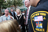 On the 10th anniversary of the September 11th terrorist attacks, United States Secretary of State Hillary Rodham Clinton (left), wife of former U.S. President Bill Clinton, appears at the opening day of the September 11th Memorial at the World Trade Center site in New York, New York on September 11, 2011..Credit: Jefferson Siegel / Pool via CNP