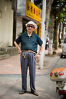 Taidazhang, retired, age 73, poses for a portrait in Nanjing. Response to 'What does China mean to you?': 'China is better and better.'  Response to 'What is your role in China's future? or What is China's role in the future?': '[no answer]'