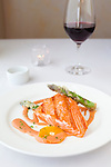 Alloro Restaurant, a fine dining restaurant located in Old Town Bandon, Oregon. Grilled local Coquille River King wild salmon, blood orange sabayon, tempura asparagus, caramelized fennel, chive