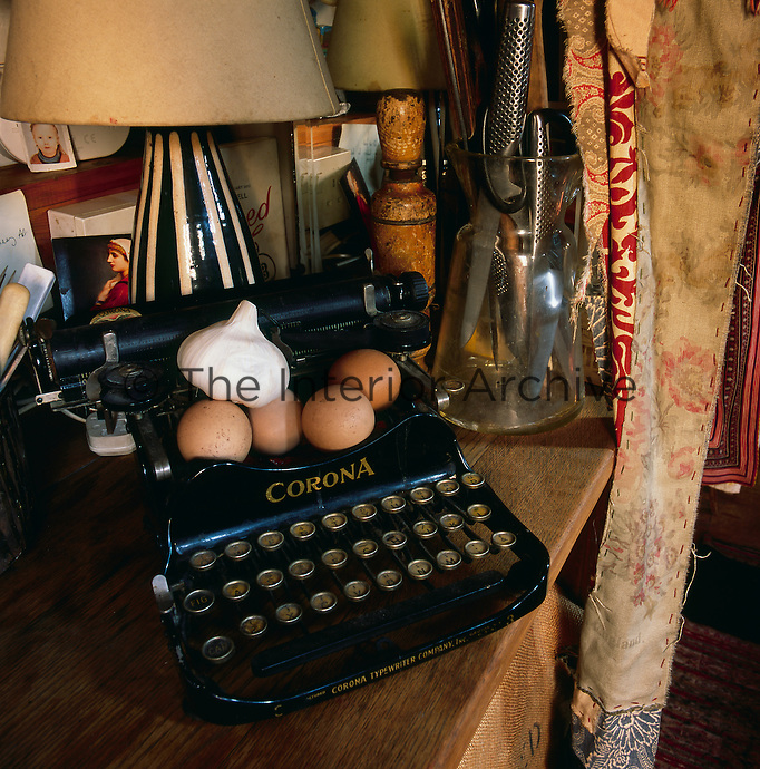 Eggs and a bulb of garlic are propped on an old Corona typewriter. One of the many interesting items displayed inside a bohemian canal boat