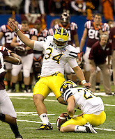 Brendan Gibbons of Michigan kicks a field goal during Sugar Bowl game at Mercedes-Benz SuperDome in New Orleans, Louisiana on January 3rd, 2012.   Michigan defeated Virginia Tech, 23-20 in first overtime.