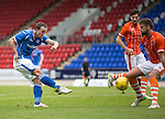 St Johnstone v Blackpool...25.07.15  McDiarmid Park, Perth.. Pre-Season Friendly<br /> Chris Kane's shot is blocked by Clark Robertson<br /> Picture by Graeme Hart.<br /> Copyright Perthshire Picture Agency<br /> Tel: 01738 623350  Mobile: 07990 594431