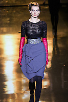 Andreea Diaconu walks runway in an outfit from the Badgley Mischka Fall 2011 fashion show, during Mercedes-Benz Fashion Week Fall 2011.