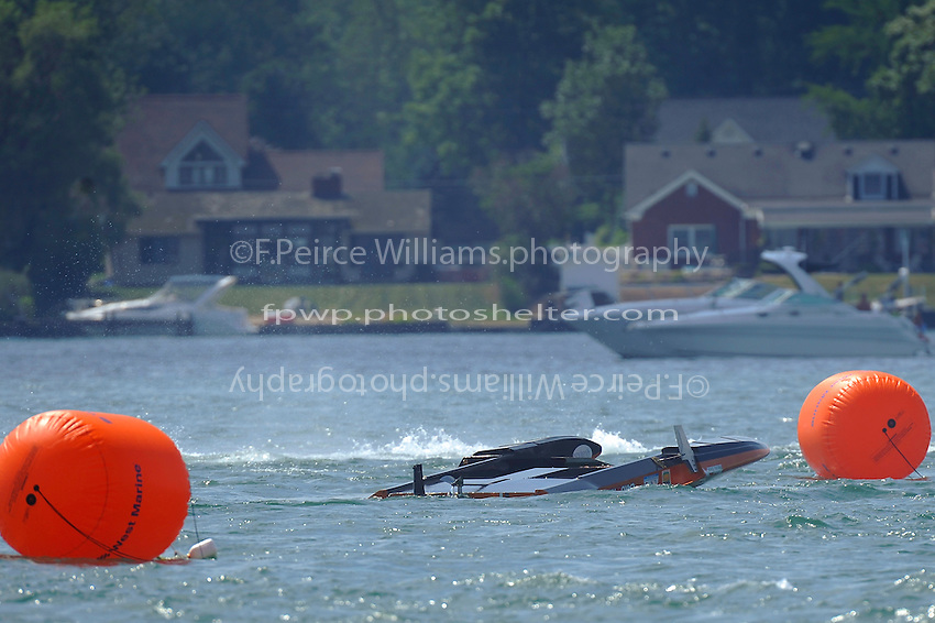 CE-16 flipped in turn two.  (5 Litre class hydroplane(s)