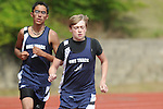 Oxford Middle School's Pruett Griffin (right) and Ivan Lopez run in the 3200 meters at a track meet in Oxford, Miss. on Thursday, April 7, 2011.