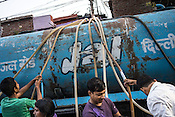 Residents gather to collect water from a Delhi Jal Board water tanker in the slums of Govind Puri in New Delhi, India. The Delhi Jal Board distributes multiple tankers of free water to all residents in the slum area. Photo: Sanjit Das for The Foreign Policy
