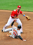 19 June 2011: Washington Nationals' infielder Danny Espinosa doubles off Nick Markakis during action against the Baltimore Orioles at Nationals Park in Washington, District of Columbia. The Orioles defeated the Nationals 7-4 in inter-league play, ending Washington's 8-game winning streak. Mandatory Credit: Ed Wolfstein Photo