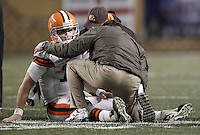 PITTSBURGH, PA - DECEMBER 08:  Colt McCoy #12 of the Cleveland Browns lays on the ground while speaking to athletic trainers after a helmet to helmet hit from James Harrison #92 of the Pittsburgh Steelers during the game on December 8, 2011 at Heinz Field in Pittsburgh, Pennsylvania.  (Photo by Jared Wickerham/Getty Images)