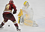 10 February 2012: Boston College Eagles forward Michael Sit, a Freshman from Edina, MN, challenges goaltender Rob Madore, a Senior from Pittsburgh, PA, during a game against the University of Vermont Catamounts at Gutterson Fieldhouse in Burlington, Vermont. The Eagles defeated the Catamounts 6-1 in their Hockey East matchup. Mandatory Credit: Ed Wolfstein Photo