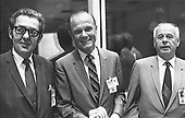 On hand in Houston's mission control center to witness activity associated with the landing and recovery operations for the Apollo 11 mission on July 24,1969 were, from the left, Bob Kline, chief of the Mission Operations Procurement Branch at the Manned Spacecraft Center (MSC); astronaut John H. Glenn Jr.; and Eberhard Rees, deputy director of the Marshall Space Flight Center (MSFC). They were among a large number of personnel on hand in the MCC's mission operations control room (MOCR). Glenn holds one of the dozens of flags that were handed out for the return's celebration..Credit: NASA via CNP