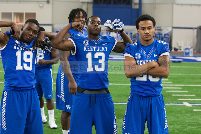 Cornerback Jaleel Hytchye, wide receiver Jeff Badet, and cornerback Kendall Randolph pose during UK football media day at Nutter Field House in Lexington, Ky., on Friday, August 8, 2014. Photo by Adam Pennavaria | Staff