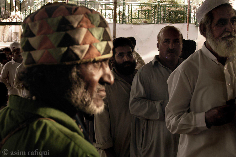bari imam shrine, islamabad, pakistan 2004: pilgrims wait in line to visit the burial place of bari imam.  with hundreds of thousands of people coming at the annual 'urs' people have to at times wait for over an hour.<br />