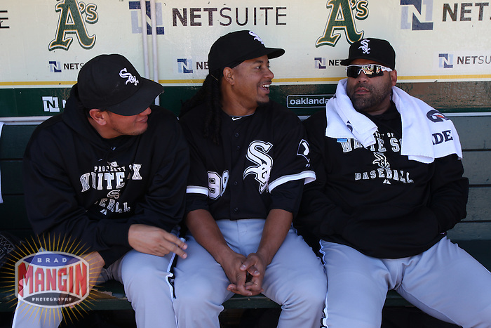 OAKLAND, CA - SEPTEMBER 22:  Freddy Garcia #43, Manny Ramirez #99, and Ramon Castro #27 of the Chicago White Sox sit in the dugout before the game against the Oakland Athletics at the Oakland-Alameda County Coliseum on September 22, 2010 in Oakland, California. Photo by Brad Mangin