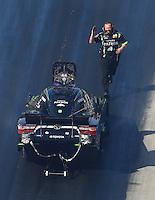 Jun 17, 2016; Bristol, TN, USA; Crew member with NHRA funny car driver Alexis DeJoria during qualifying for the Thunder Valley Nationals at Bristol Dragway. Mandatory Credit: Mark J. Rebilas-USA TODAY Sports