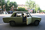 A man waiting in his Lada in Tashkent