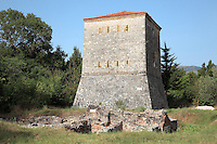 Venetian Tower, a massive square blockhouse built by the Venetians in late 15th - early 16th century, Butrint, Chaonia, Albania. This tower was built to work in tandem with the Triangular Fortress to protect valuable fishing weirs. It has a drawbridge and battered sides to withstand attack. Venice capitulated to Napoleon Bonaparte in 1797, when Butrint fell into the hands of the infamous local despot Ali Pasha of Tepelena. Butrint was founded by the Greek Chaonian tribe and was a port throughout Hellenistic and Roman times, when it was known as Buthrotum. It was ruled by the Byzantines and the Venetians and finally abandoned in the Middle Ages. The ruins at Butrint were listed as a UNESCO World Heritage Site in 1992. Picture by Manuel Cohen