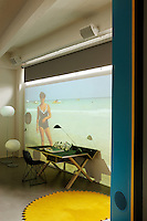 "A video installation entitled ""Horizons IV"" by Celine Duval takes up an entire wall of the bedroom"