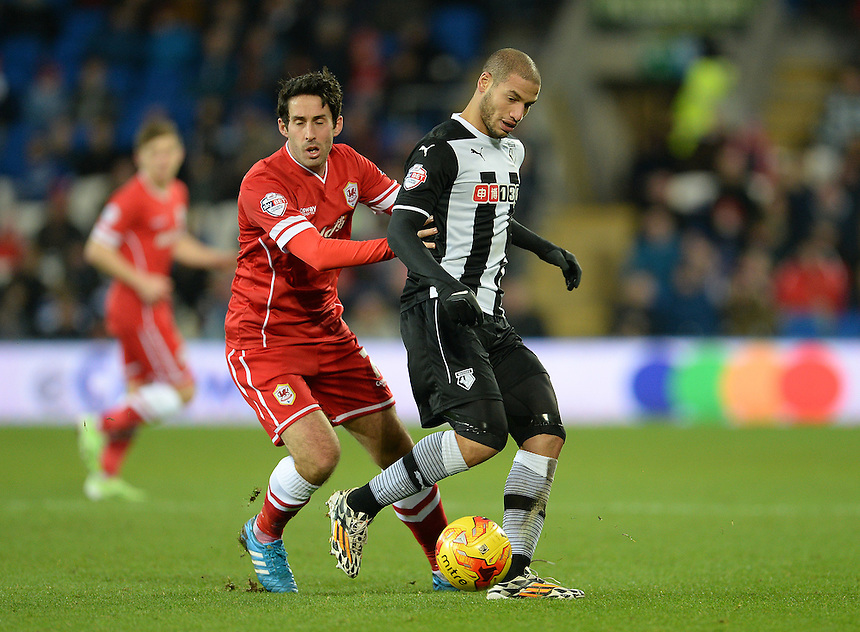 Watford's Adlene Guedioura shields the ball from Cardiff City's Peter Whittingham<br /> <br /> Photographer Ian Cook/CameraSport<br /> <br /> Football - The Football League Sky Bet Championship - Cardiff City v Watford - Saturday 28th December - Cardiff City Stadium - Cardiff<br /> <br /> &copy; CameraSport - 43 Linden Ave. Countesthorpe. Leicester. England. LE8 5PG - Tel: +44 (0) 116 277 4147 - admin@camerasport.com - www.camerasport.com