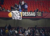 FUSSBALL   INTERNATIONAL   UEFA EUROPA LEAGUE   SAISON 2012/2013    Achtelfinale Hinspiel VfB Stuttgart - Lazio Rom      07.03.2013 Lazio Fans mit einem Plakat Dessau