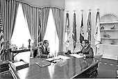 """United States President Richard M. Nixon, left, meets privately with his Chief of Staff Harry Robbins """"H.R."""" Haldeman, right,  in the Oval Office of the White House in Washington, D.C. on February 10, 1971..Credit: White House via CNP"""
