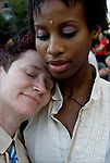 Head and shoulders portrait of two lesbians in Washington Square Park after the end of the Dyke March down 5th Avenue. African American wear bindi to honor third eye. Caucasian is wearing a tie. Releases #2500 and 2501