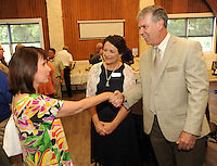 NWA Democrat-Gazette/ANDY SHUPE<br /> The Rev. Leslie Belden (left), parish associate at First United Presbyterian Church, speaks Wednesday May 25, 2016, with Jess Schload (right) and his wife, Connie Bartosiewicz, during a reception for Schload who was introduced as the new CEO of Mount Sequoyah Retreat and Conference Center in Fayetteville.