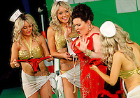 Picture shows : Karen Cargill as Isabella (centre) with bunny girls..Picture  ©  Drew Farrell Tel : 07721 -735041..A new Scottish Opera production of  Rossini's 'The Italian Girl in Algiers' opens at The Theatre Royal Glasgow on Wednesday 21st October 2009..(Soap) opera as you've never seen it before..Tonight on Algiers.....Colin McColl's cheeky take on Rossini's comic opera is a riot of bunny girls, beach balls, and small screen heroes with big screen egos. Set in a TV studio during the filming of popular Latino soap, Algiers, the show pits Rossini's typically playful and lyrical music against the shoreline shenanigans of cast and crew. You'd think the scandal would be confined to the outrageous storylines, but there's as much action off set as there is on.... .Italian bass Tiziano Bracci makes his UK debut in the role of Mustafa. Scottish mezzo-soprano Karen Cargill, who the Guardian called a 'bright star' for her performance as Rosina in Scottish Opera's 2007 production of The Barber of Seville, sings Isabella. .Cast .Mustafa...Tiziano Bracci.Isabella..Karen Cargill.Lindoro...Thomas Walker.Elvira...Mary O'Sullivan.Zulma...Julia Riley.Haly...Paul Carey Jones.Taddeo...Adrian Powter. .Conductors.Wyn Davies.Derek Clarke (Nov 14). .Director by Colin McColl.Set and Lighting Designer by Tony Rabbit.Costume Designer by Nic Smillie..New co-production with New Zealand Opera.Production supported by.The Scottish Opera Syndicate.Sung in Italian with English supertitles..Performances.Theatre Royal, Glasgow - October 21, 25,29,31..Eden Court, Inverness - November 7. .His Majesty's Theatre, Aberdeen  - November 14..Festival Theatre,Edinburgh - November 21, 25, 27 ...Note to Editors:  This image is free to be used editorially in the promotion of Scottish Opera. Without prejudice ALL other licences without prior consent will be deemed a breach of copyright under the 1988. Copyright Design and Patents Act  and will be subject to payment or legal action, where appropriate..Further f