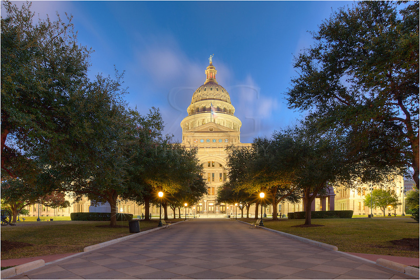 Looking down the main walkway to the state capitol in Austin, Texas, the building seems to shine in the early minutes of first light on a cold November morning.