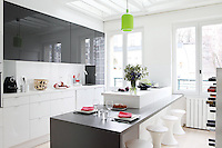 A dining/breakfast bar area is moulded around the kitchen island in this contemporary style kitchen