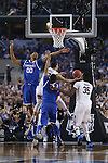 UK forward  Marcus Lee (00) goes to block UConn guard Shabazz Napier's (13) shot during the NCAA Championship vs. UConn at the AT&T Stadium in Arlington, Tx., on Monday, April 7, 2014. Photo by Emily Wuetcher | Staff