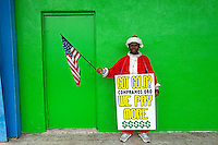 John Leo, from Nigeria, works on Christmas Eve Day in Houston, Texas. With gold prices at an all-time high, the holiday season is one of the busiest times of the year for gold buyers.