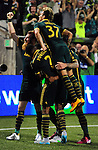 Jun 6, 2015; Portland, OR, USA; Portland Timbers Portland Timbers defender Nat Borchers (7), defender Alvas Powell (2) and midfielder Maximiliano Urruti (37) celebrate with Portland Timbers forward Fanendo Adi (9) after he scored a goal during the second half of the game against the New England Revolution at Providence Park. The Timbers won the game 2-0. Mandatory Credit: Steve Dykes-USA TODAY Sports