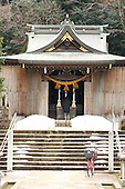 Jan. 21, 2009; Obama, Fukui Prefecture, Japan - A woman stops to pray and give an offering at the Hachiman Shrine.