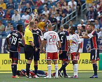 New York Red Bulls forward Dane Richards (19) receives yellow card warning. In a Major League Soccer (MLS) match, New England Revolution defeated New York Red Bulls, 2-0, at Gillette Stadium on July 8, 2012.