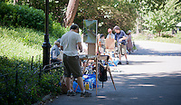Artists take advantage of the not too hot summer weather to work on their canvas' in Central Park in New York during a plein air painting class on Wednesday, June 27, 2012. (© Richard B. Levine)