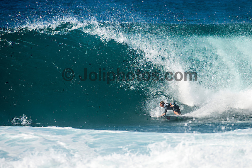 Backdoor, Oahu/Hawaii (Friday, December 12, 2014) Tom Curren (USA) surfing Backdoor.-  Photo: joliphotos.com