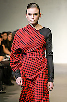 "Model walks runway in a Mikevensel Fall/Winter 2011 ""Mies Maasai"" collection outfit my Mike Vensel, during CONCEPT New York Fashion Week."