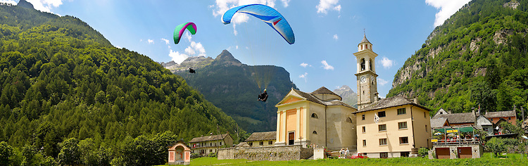 Paragliders over the Baroque church at Sonogno, Val Verzasca, Tocino, Swiss alps