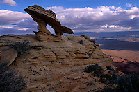 Wind eroded sandstone crests above a 3,000 foot escarpment of the Vermilion Cliffs overlooking the Grand Canyon in northern Arizona. Vast scale makes the Colorado River's down-cutting appear as a series of narrow, winding incisions near Marble Canyon.  The remote 293,000 acre monument in the Colorado Plateau features a majestic grand terrace rising at the edge of the Paria Plateau.