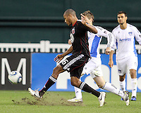 Jordan Graye #16 of D.C. United takes a shot past Bobby Convey #11 of the San Jose Earthquakes during an MLS match at RFK Stadium in Washington D.C. on October 9 2010. San Jose won 2-0.