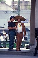 Mariachi player embracing a friend in Plaza Garibaldi, Mexico City, Mexico